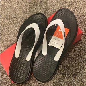 Brand new in box Nike flip flops size 9